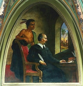 Painting of Bartolome de las Casa and a Native American as he writes of their destruction.